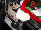 Santa boots on tan FloorLiner, BY WEATHERTECH