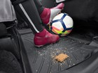 Broken granola bar and soccer ball on FloorLiner. BY WEATHERTECH