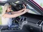 women installing front windshield SunShade BY WEATHERTECH