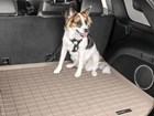 Dog secured with Pet Safety Harness in cargo area. BY WEATHERTECH