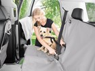 Dog buckled into back seat with safety harness. BY WEATHERTECH