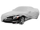 Gray Indoor Car Cover partially on a Mercedes. BY WEATHERTECH