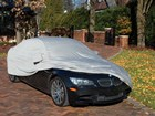 Gray Outdoor Car Cover partially covering a BMW.  BY WEATHERTECH