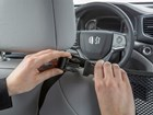 hands adjusting Pet Partition snaps BY WEATHERTECH