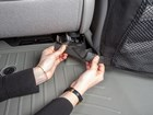 hands adjusting Pet Partition straps BY WEATHERTECH