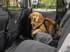 dog sitting on a grey Seat Protector BY WEATHERTECH