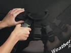 hands adjusting the RackSack straps BY WEATHERTECH