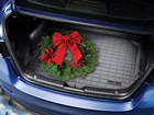 christmas wreath on a Cargo Liner in a blue car BY WEATHERTECH