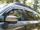 women driving SUV with Side Window Deflector BY WEATHERTECH