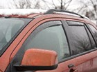 Side Window Deflector on red SUV with snow BY WEATHERTECH