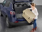 Young Woman loading a cooler into an SUV. BY WEATHERTECH