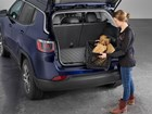 Woman loading firewood into cargo area of SUV.  BY WEATHERTECH