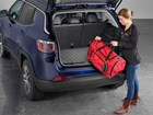 Young Woman loading a duffel bag into SUV.  BY WEATHERTECH
