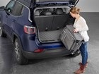 Young Woman loading luggage into back of SUV. BY WEATHERTECH