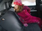 child in winter clothes on a Seat Protector BY WEATHERTECH