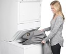 women putting Seat Protector in washing machine BY WEATHERTECH