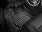 Closeup drive side black FloorLiner. BY WEATHERTECH