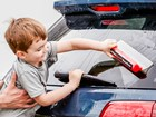 Child using WaterBlade to wipe clear car window.  BY WEATHERTECH
