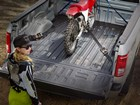 dirt bike in back of truck with TechLiner BY WEATHERTECH