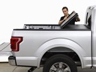 Man folding up an AlloyCover on a truck BY WEATHERTECH