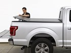 Man folding down an AlloyCover on a truck BY WEATHERTECH