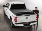 Man securing a Roll Up Truck Bed Cover. BY WEATHERTECH