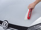 WaterBlade being used against silver VW car.  BY WEATHERTECH