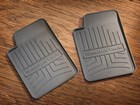 Two WeatherTech FloorLiner drink coasters. BY WEATHERTECH