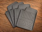 Four WeatherTech FloorLiner drink coasters. BY WEATHERTECH