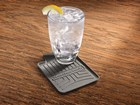 Drinking glass on FloorLiner drink coaster. BY WEATHERTECH