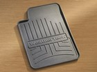 A single WeatherTech FloorLiner drink coaster. BY WEATHERTECH