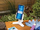 White DeskFone with phone in garden. BY WEATHERTECH