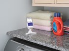 White DeskFone with phone in laundry room. BY WEATHERTECH