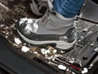 Snowy and muddy boots on a black FloorLiner. BY WEATHERTECH