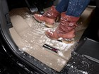 Leather snowy boots on a driver side FloorLiner. BY WEATHERTECH