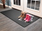 IndoorMat inside home with boots on it. BY WEATHERTECH