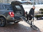 Woman and Dog using a Pet Ramp in the winter. BY WEATHERTECH