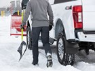 Mudflap on truck with snow falling. BY WEATHERTECH