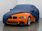 Dark Blue Indoor Car Cover partially on a BMW.  BY WEATHERTECH