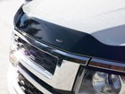 close up view of Hood Protector on white SUV BY WEATHERTECH