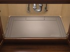 Tan SinkMat under sink cabinet.  BY WEATHERTECH