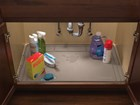 Tan SinkMat in sink cabinet with water spill. BY WEATHERTECH