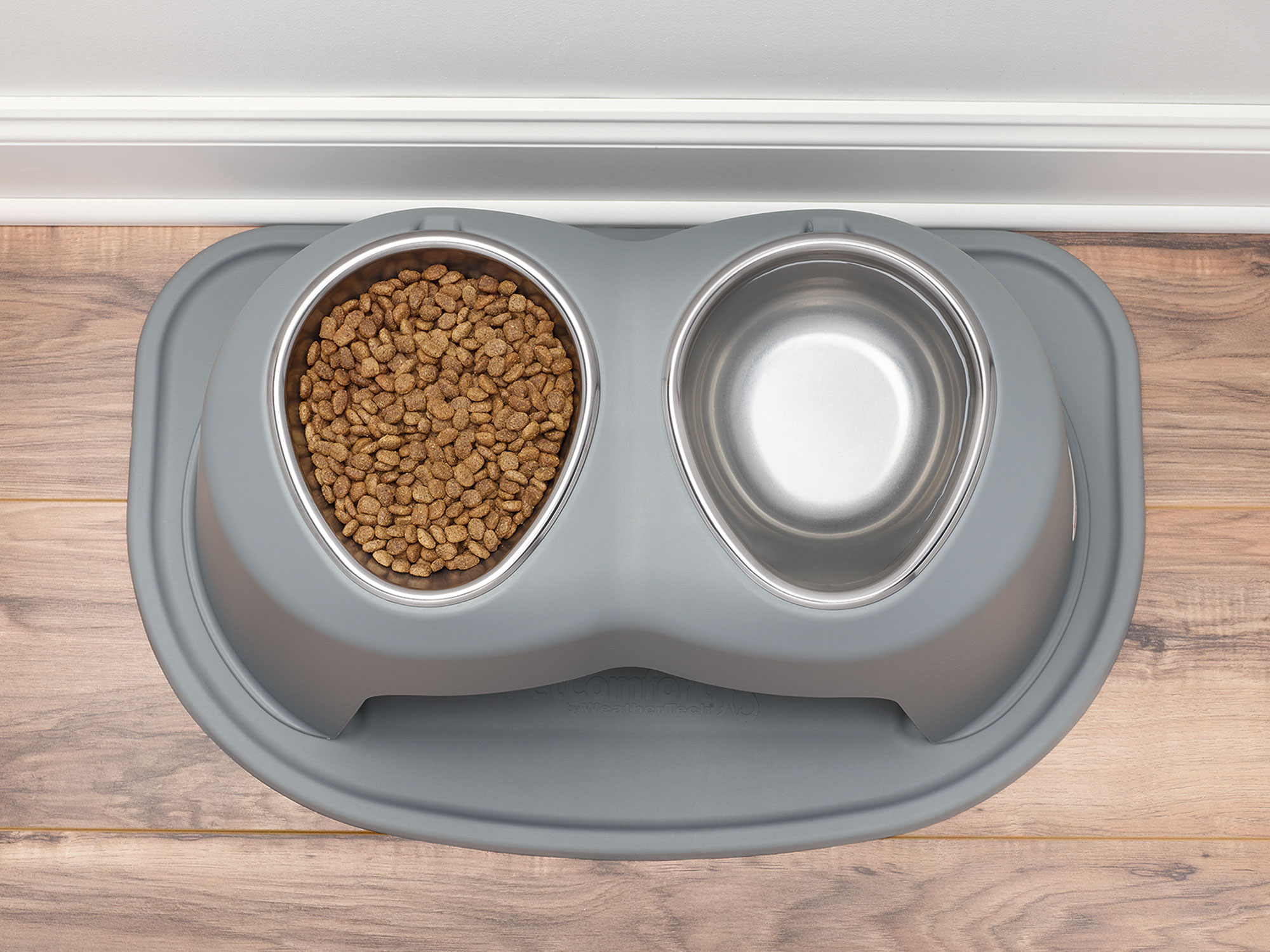 WeatherTech dog bowl stand and protective mat keep mealtime messes from your pet off your floors.