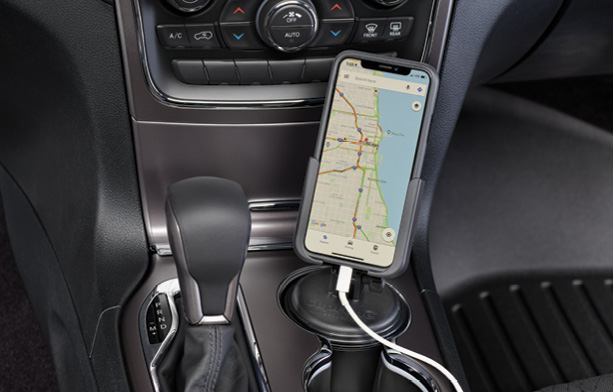WeatherTech CupFone holding a smartphone with an image of a map of Chicago on the screen.