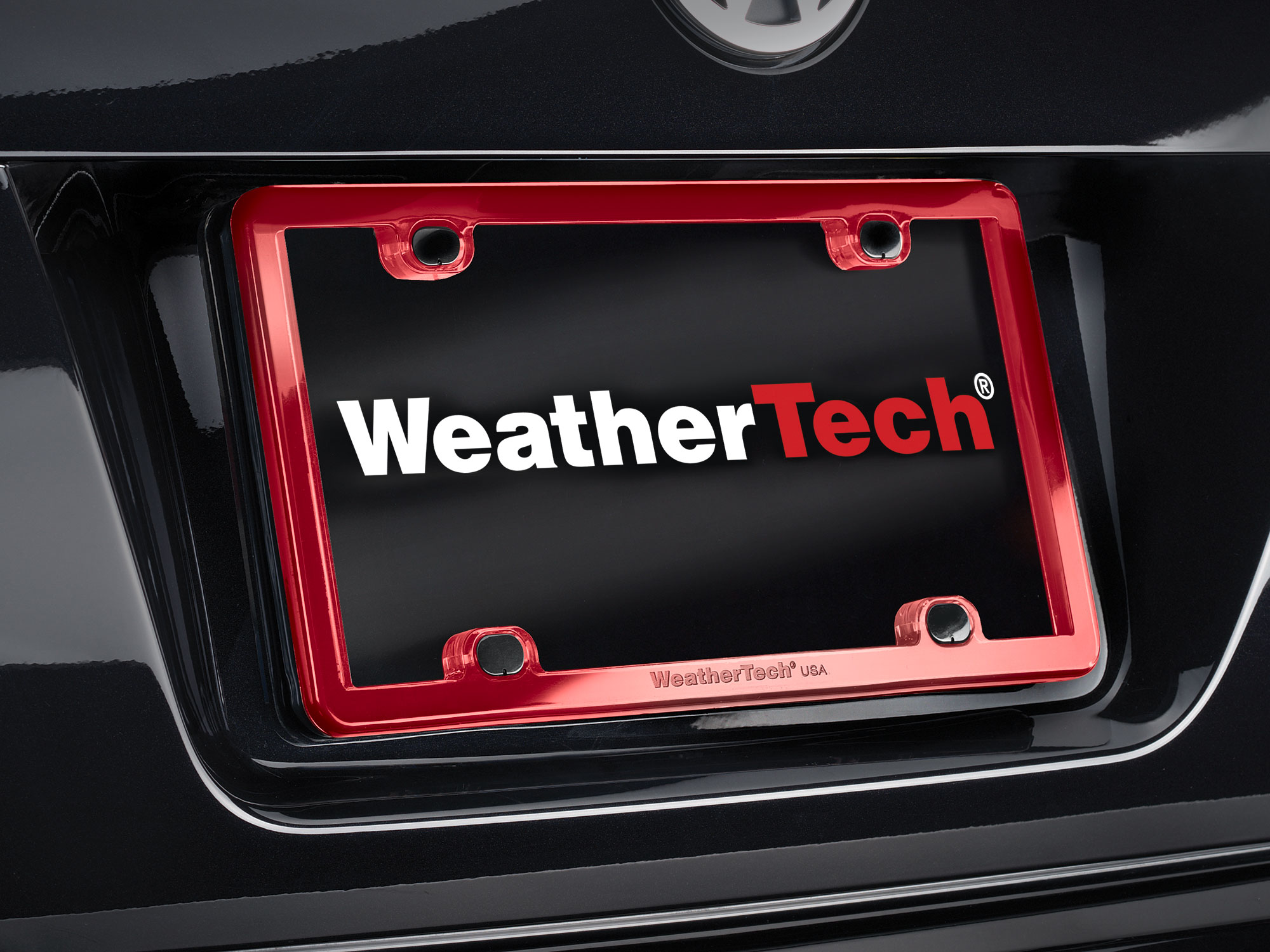 WeatherTech ClearFrame license plate frame installed on a vehicle. .