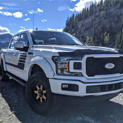 White Truck with Side Window Deflectors near mountains