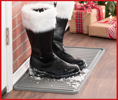 Photograph of a BootTray with Santa's boots resting on the tray in a home.
