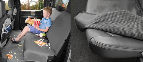 Child eating snacks on seat protector