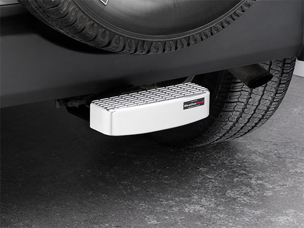 WeatherTech Billet BumpStep rear bumper protector installed on a Jeep SUV.
