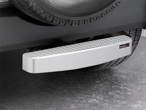 WeatherTech Billet BumpStepXL bumper protector installed on a Jeep SUV.